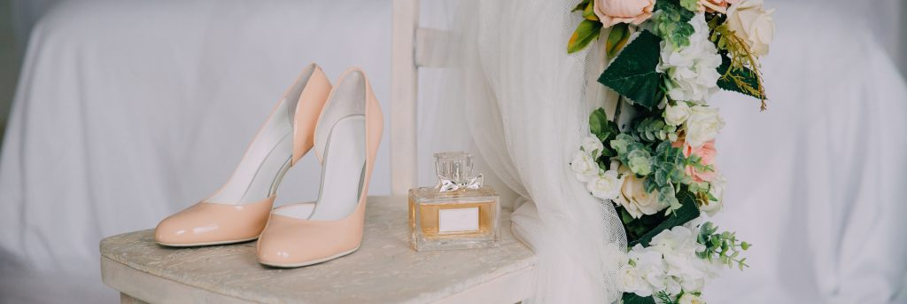 a photo of bridal accessories shoes perfume flowers