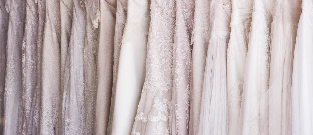 photo of wedding dresses on hangers