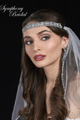 woman in marionat symphony bridal headpiece