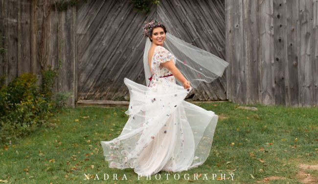 photo of bride spinning in dress